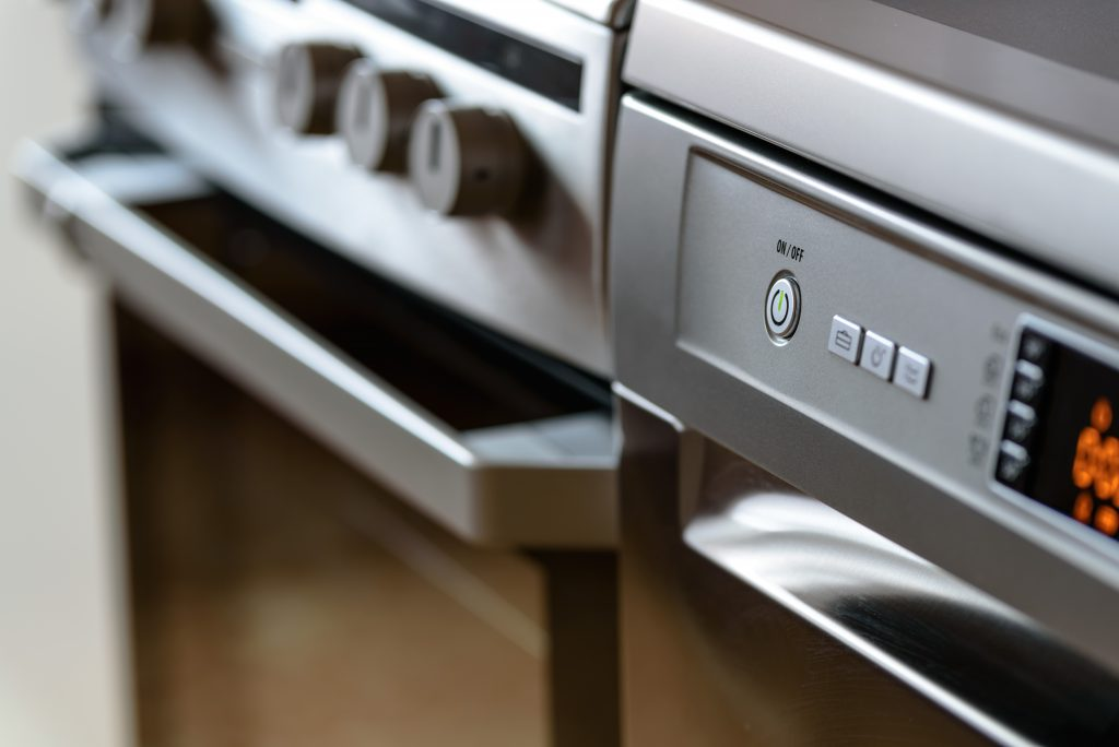 Metallic stove and dishwasher in the kitchen, where thermal management solutions are needed
