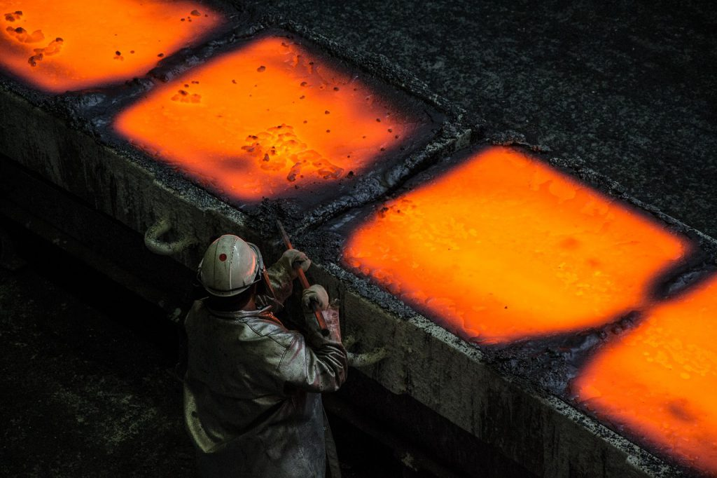 Man in front of glowing hot metallurgy trays for Elmelin high temperature insulation specialists