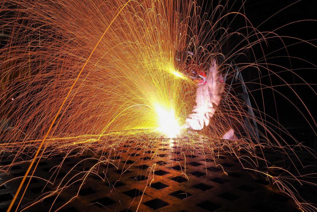 Person welding using high temperature insulation