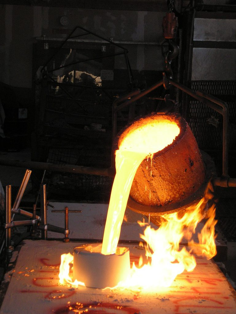 Foundry crucible pouring molten metal into mould for blog by Emelin on furnace insulation basics
