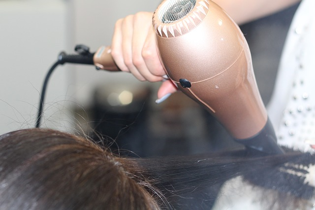 hair being dried with a hairdryer insulated with mica