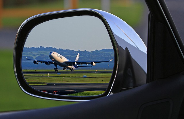 image of aeroplane in car wing mirro for blog on insulation for transportation by Elmelin
