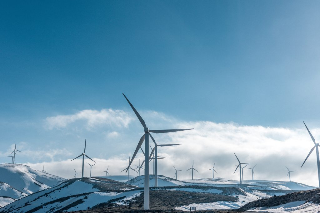 Imageof wind turbines in snow for World Environment Day blog by Elmeling, specialists in Mica based industrial insulation