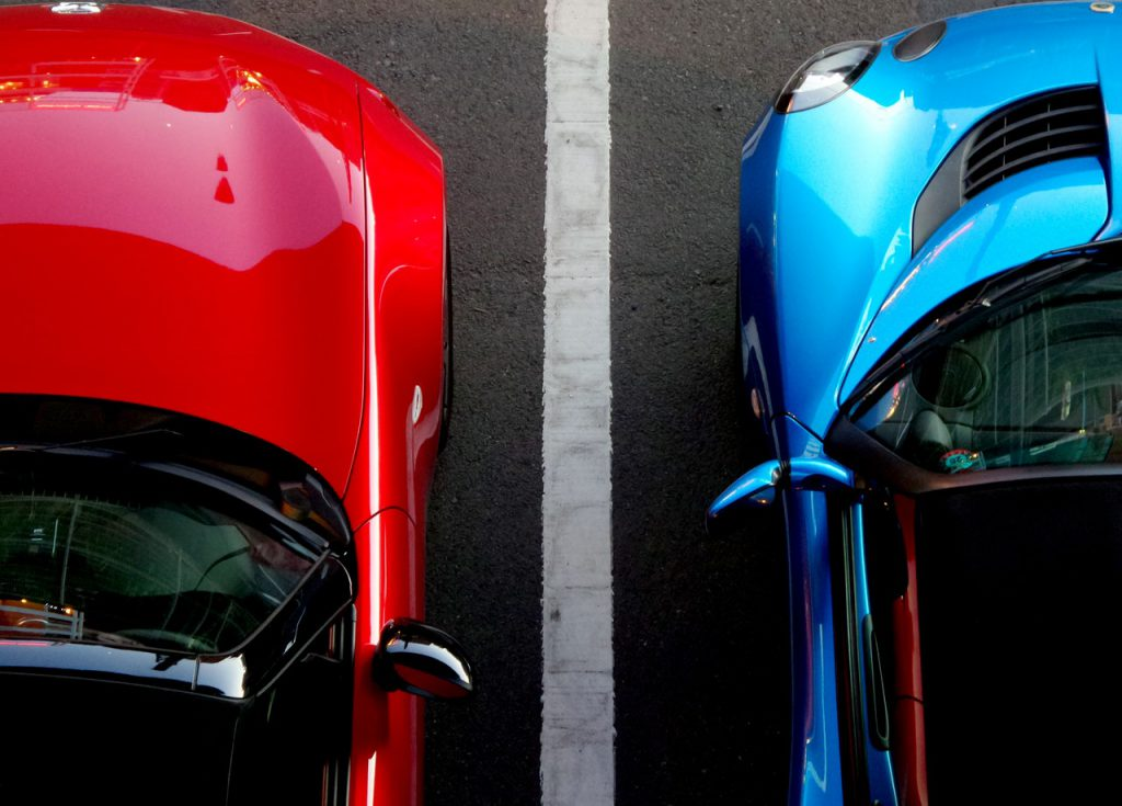 Two cars side by side to illustrate blog about industrial insulation in the automotive industry