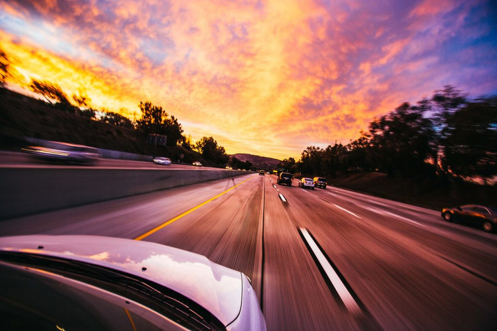 car on an open roadat sunset to illustrate blog by Elmelin on Industrail Insulation in the automotive industry