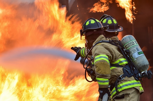 Insulation for fire protection firefighter tackling a blaze
