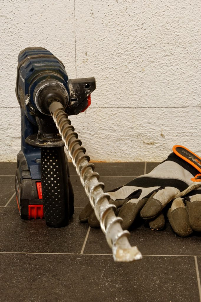 image of impact drill and gloves to illustrate blog by Elmelin on mica sheet