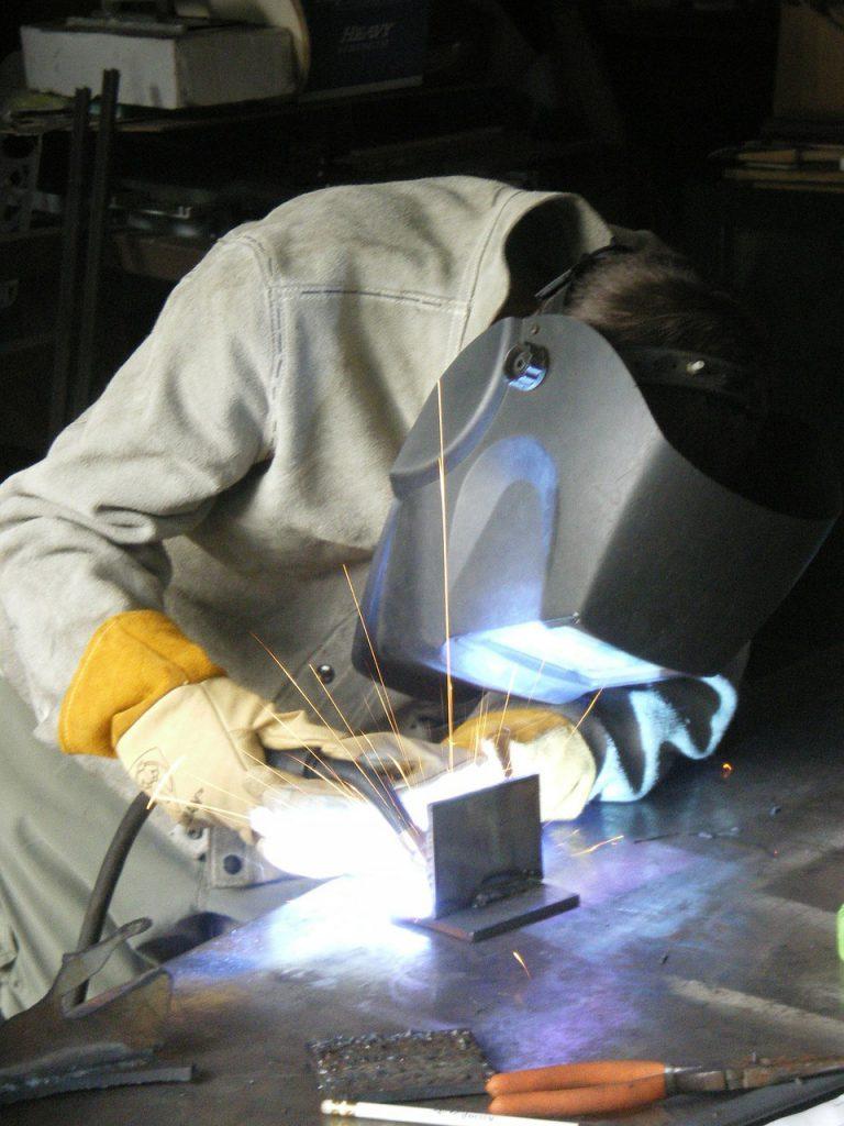 a welder making a prototype