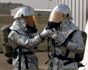 firefighters wearing protective equipment and breathing equipment for blog by Elmelin asking is mica safe