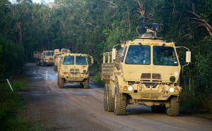 Army trucks driving for blog by Elmelin on high temperature insulation solutions for the military