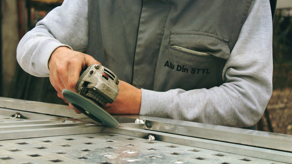 person using an angle grinder for a blog by elmelin on mica and electricity