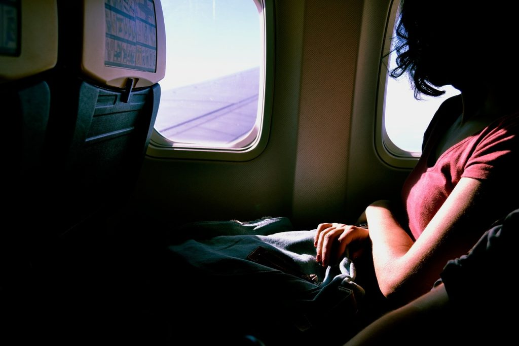 woman on an aeroplane to illustrate blog by Elmelin on thermal management in aerospace