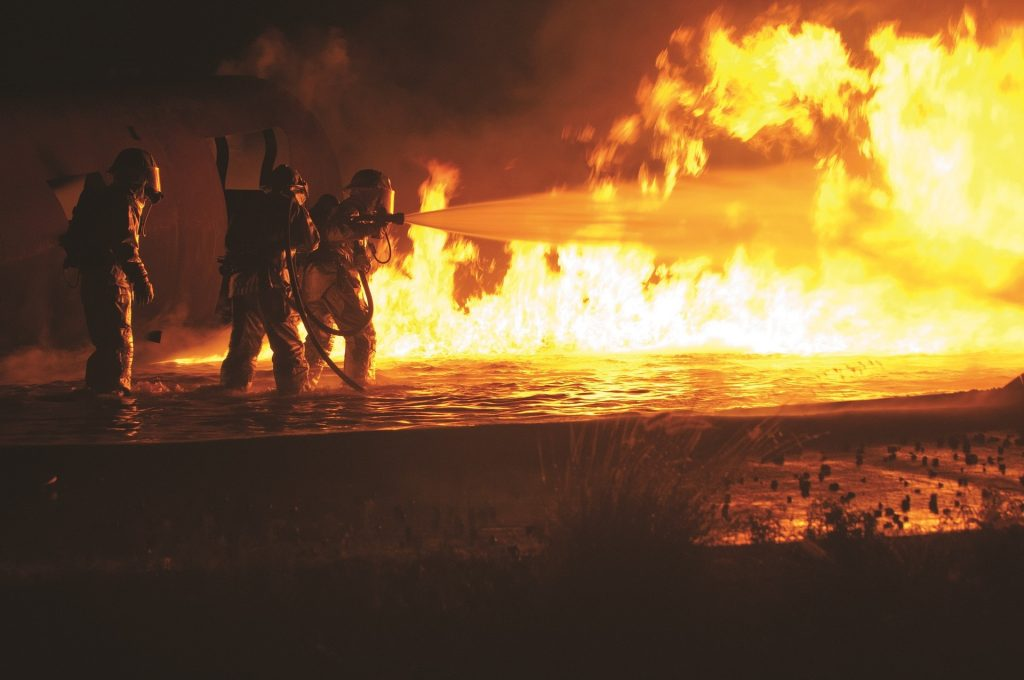 image of firefighters fighting a blaze for blog by Elmelin about the properties of Elmtherm