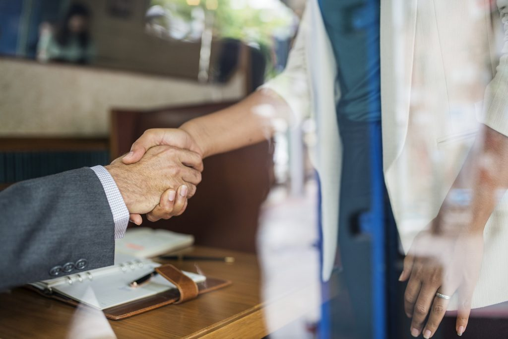 Image of people shaking hands for blog about choosing r&d partners by Elmelin