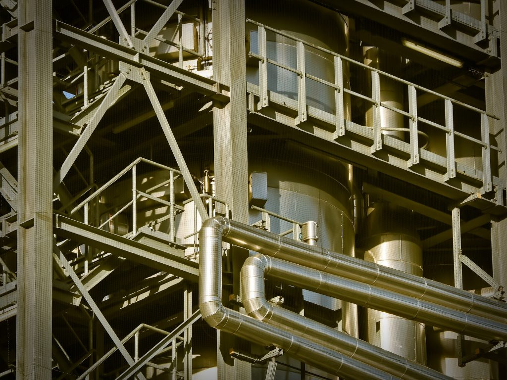 Image of factory pipes for blog by Elmelin on what materials are best for thermal insulation